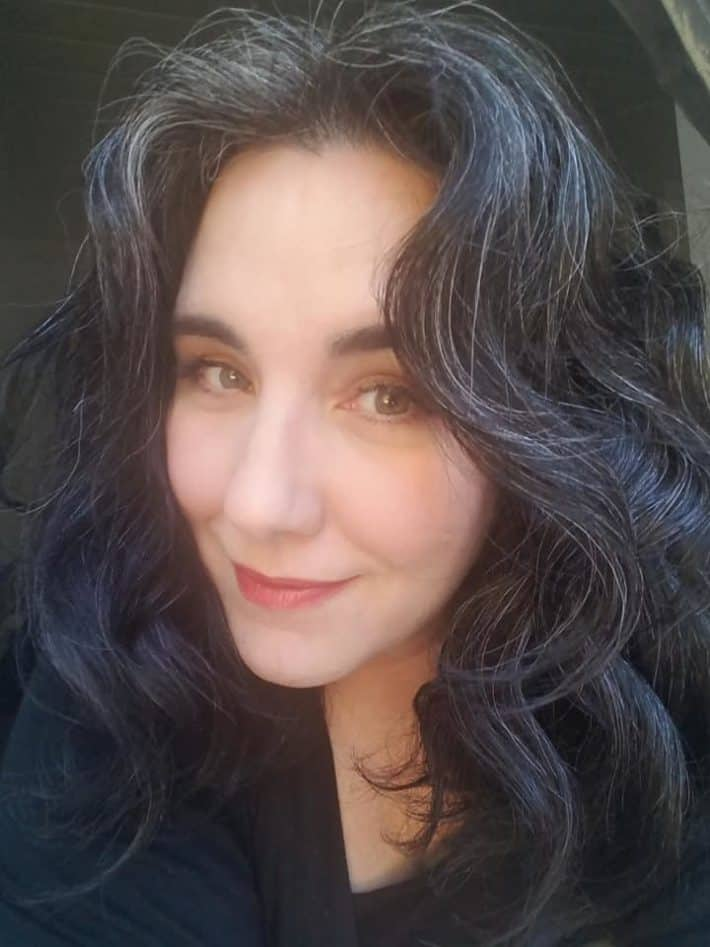 Woman with gray wavy hair