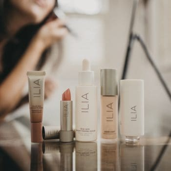 woman trying Ilia makeup products