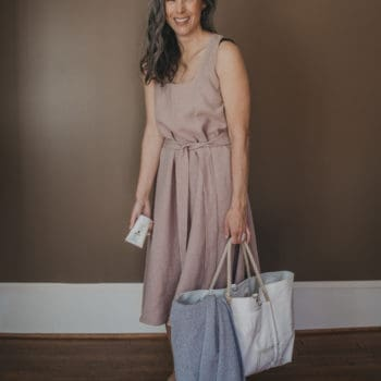 woman wearing linen beach dress and beach bag