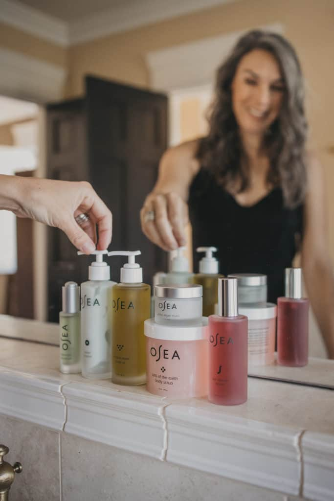 all of the OSEA lined up at the sink, reaching for the ocean cleanser