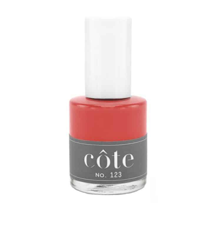 Nail polish Bottle of vibrant red color from Côte