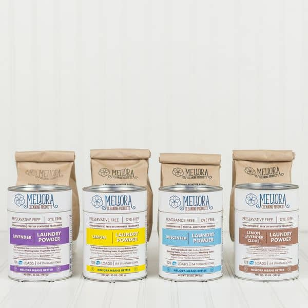 four scents of meliora laundry detergent, powdered, lined up on a counter