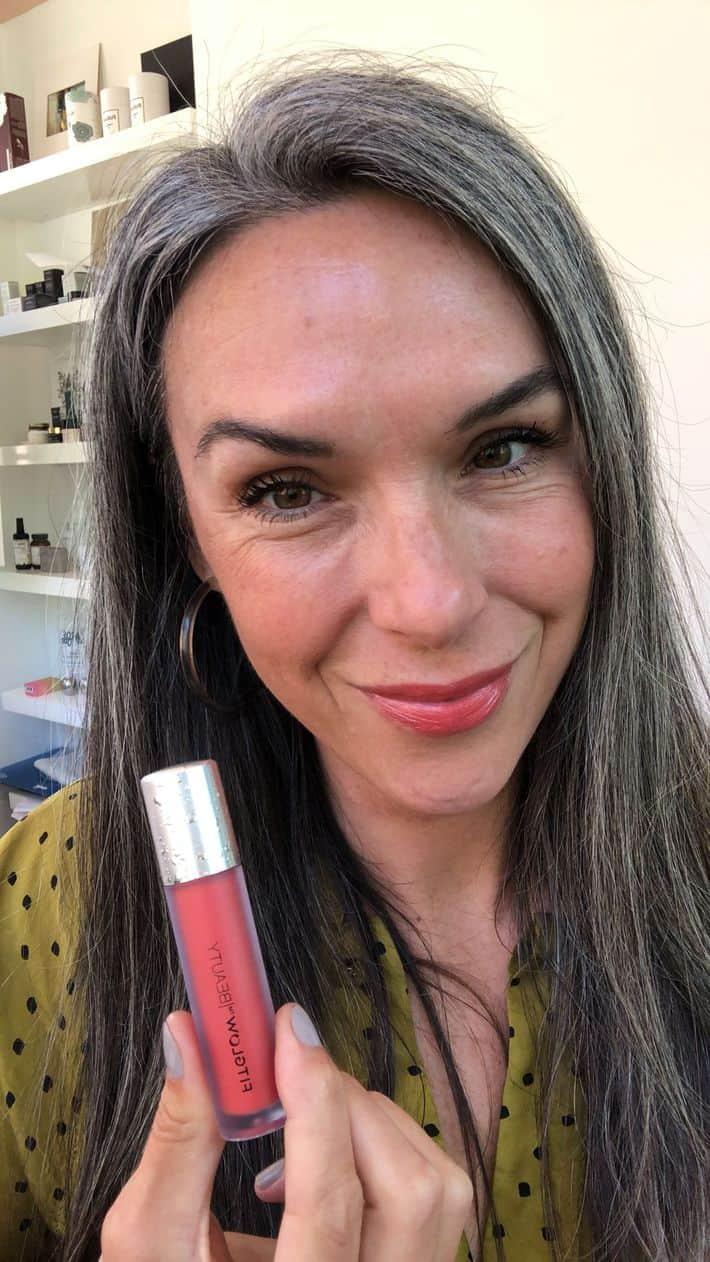 woman holding lip serum from fitglow