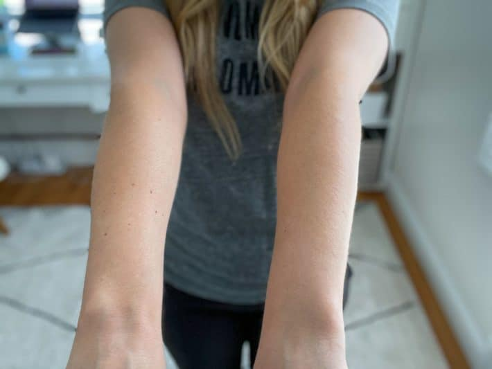 woman in grey tshirt with self tanner