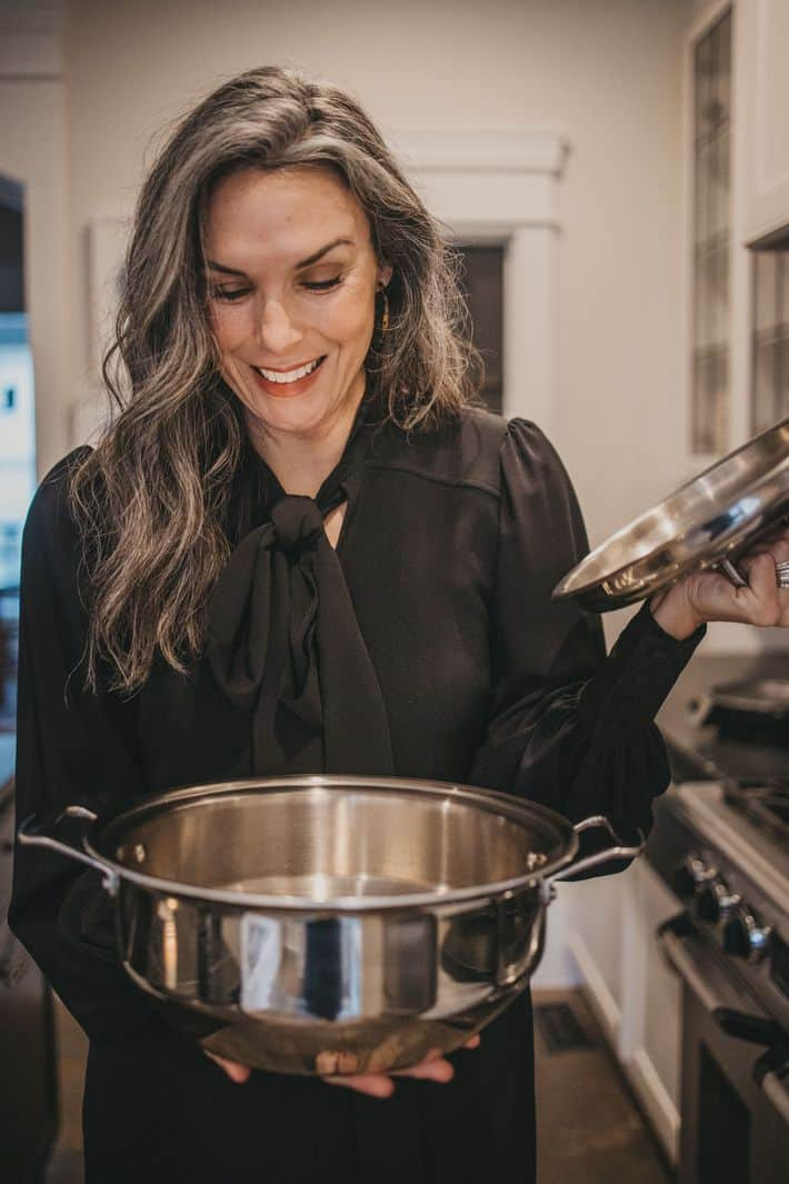 woman cooking using 360 cookware