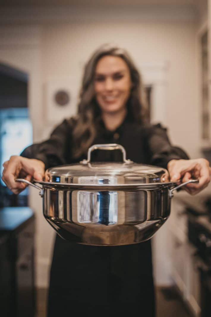 woman holding pot in hands from 360 cookware