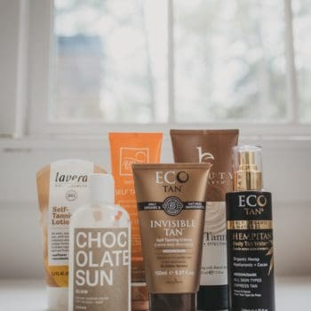 roundup of sunless tanner products on a table