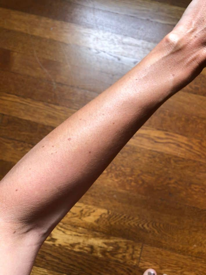 arm with self tanner from lavera