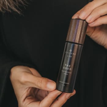 woman holding skincare for men from Caldera Lab