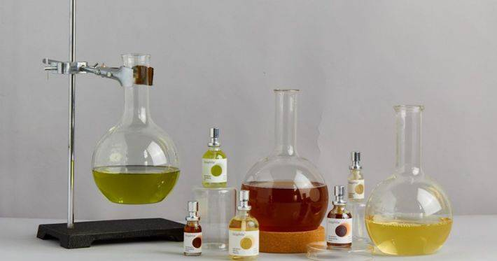 Vials and a chemistry set sit next to biophile probiotic skincare samples