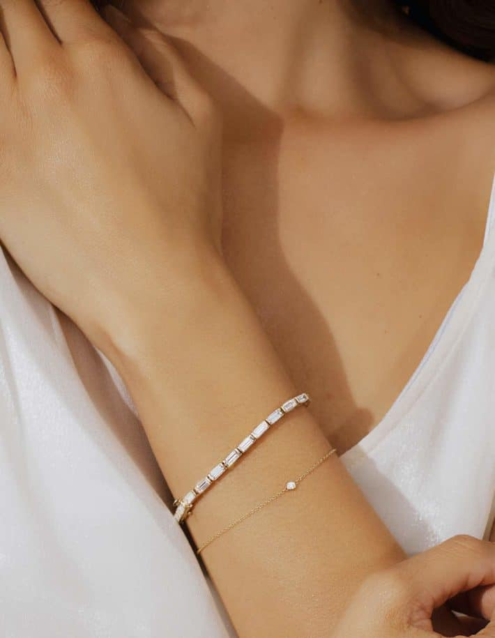 woman wearing sustainable bracelet from VRAI