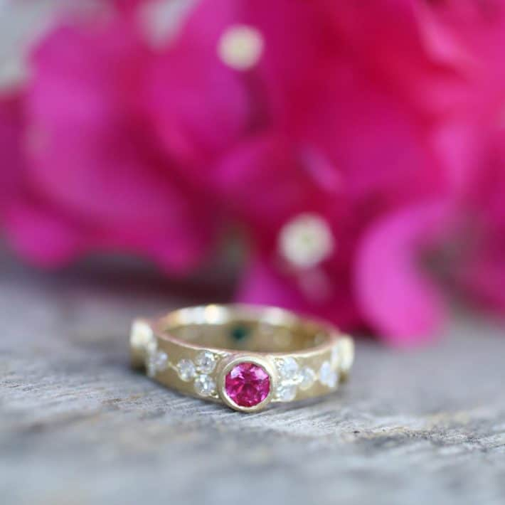 sustainable ring with red rock