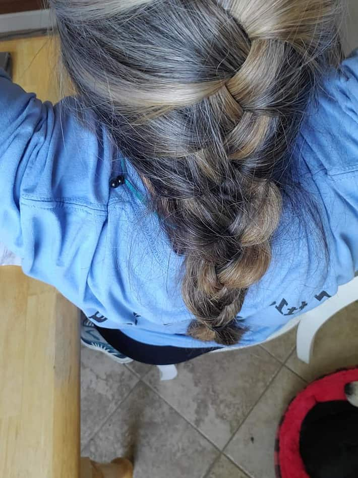 woman with braided hair gray and brown