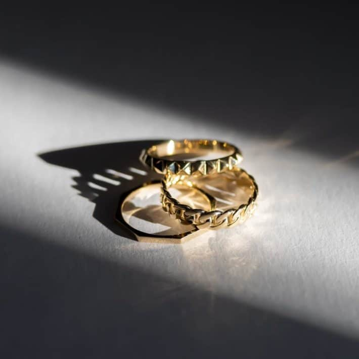 a set of two gold rings made with sustainable materials