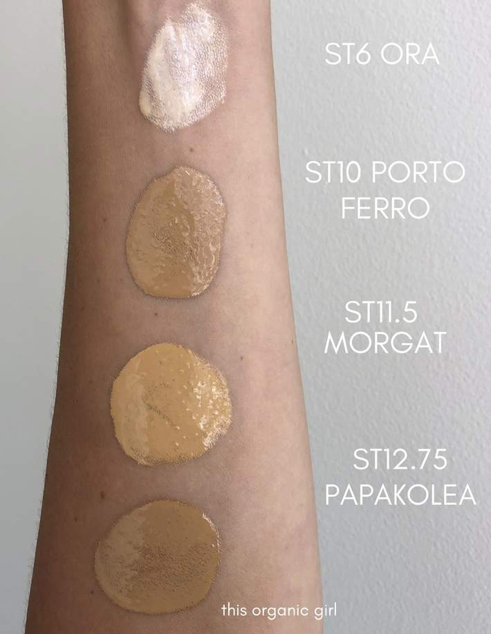 Shades of ILIA Beauty's tinted SPF swatched on a white arm.