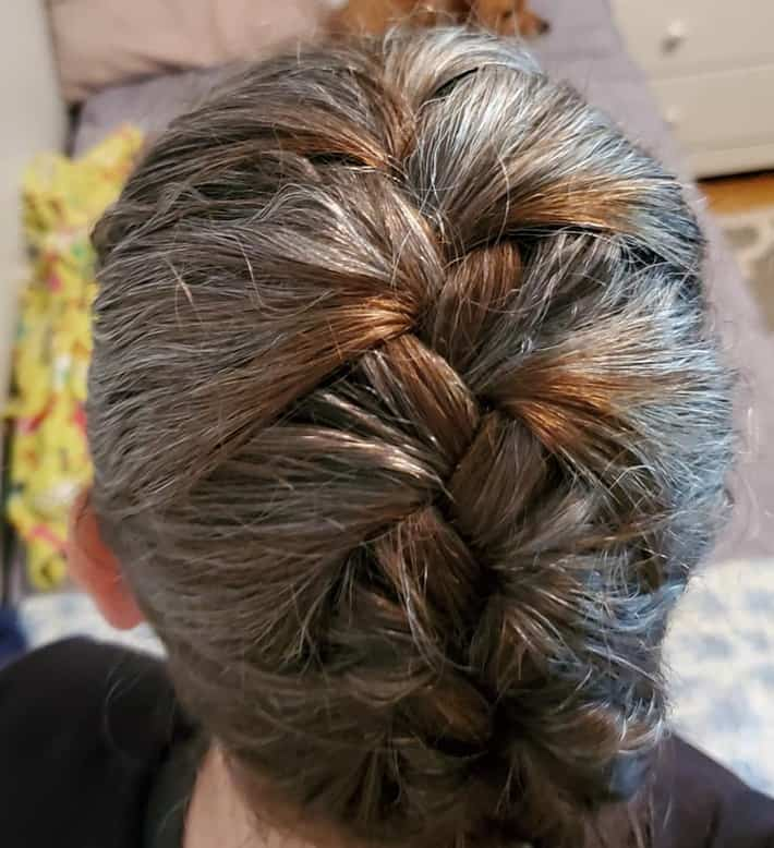 woman with braided hair gray and red