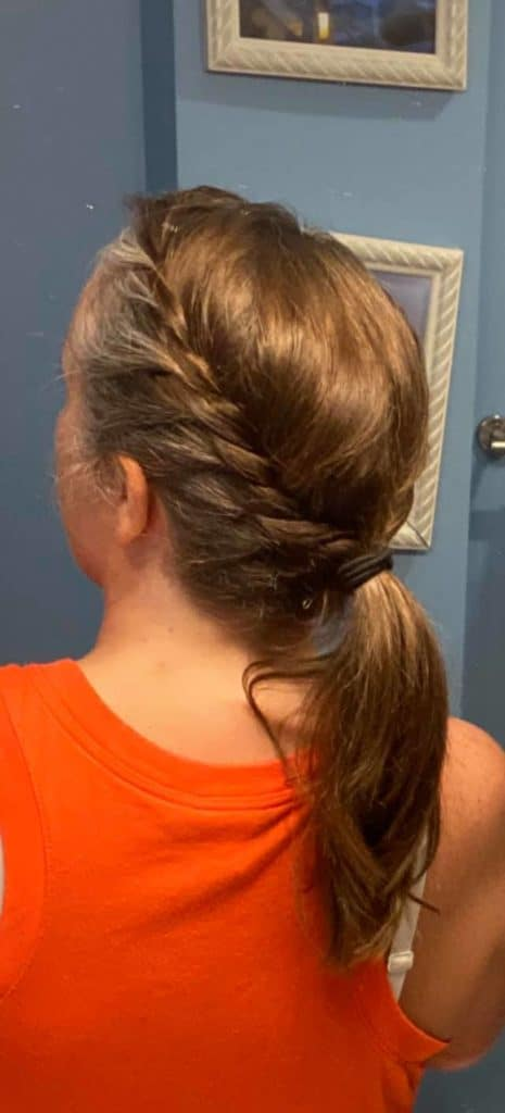 woman with braided pony tail