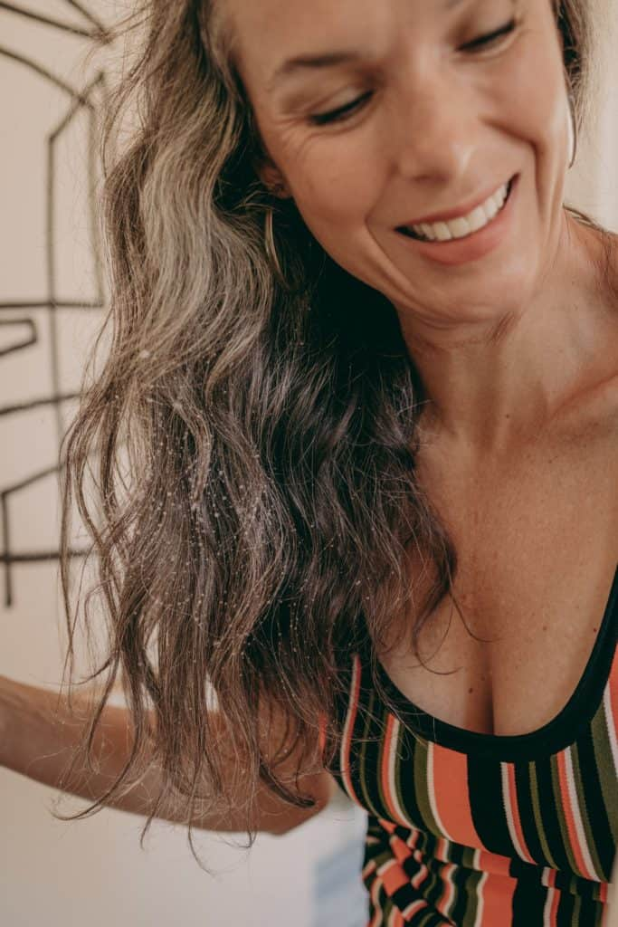 woman with gray and curly hair smiling