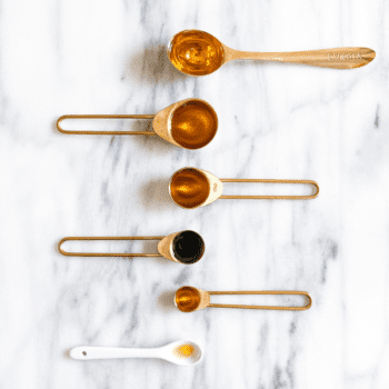 Ingredients for facial oil at home in a spoon