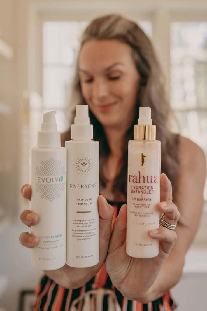 Lisa holds out three of her favorite better beauty haircare products.