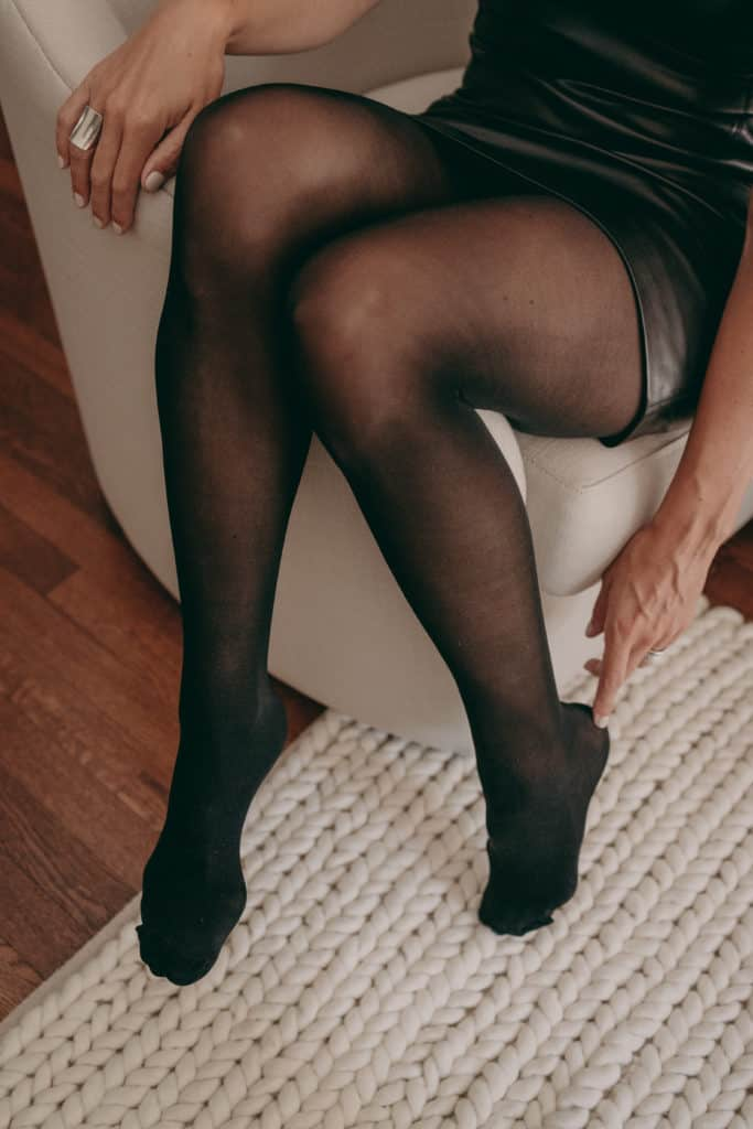 Lisa's legs in semi-opaque tights.