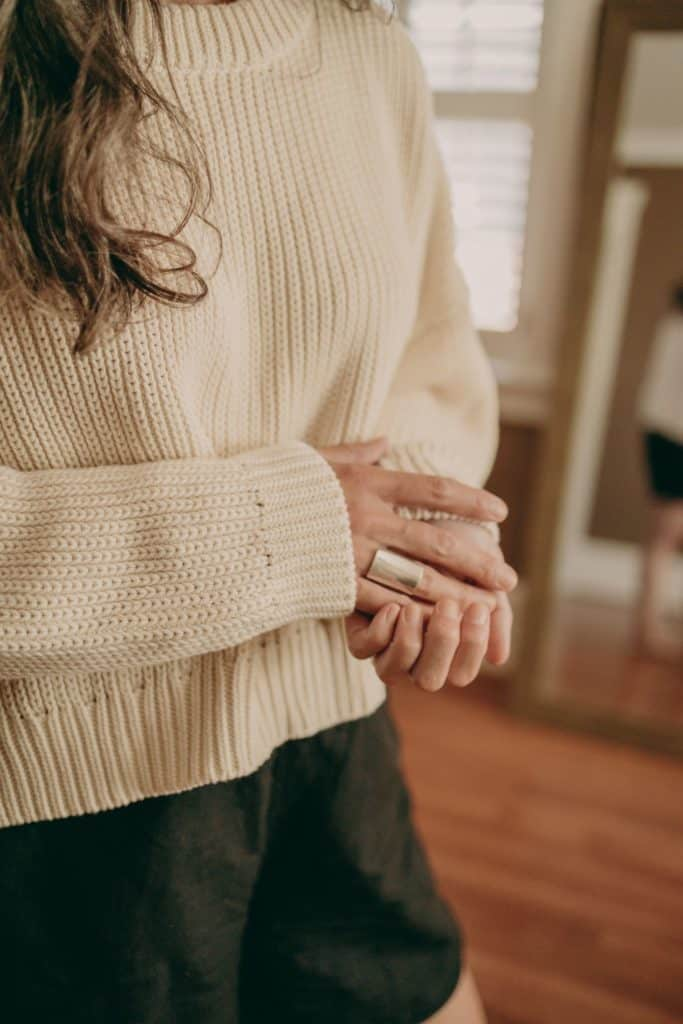 woman wearing white comfy sweater from tradlands