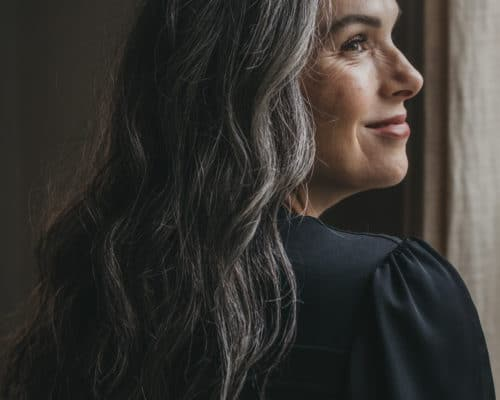 Woman with gray hair looking in the distance